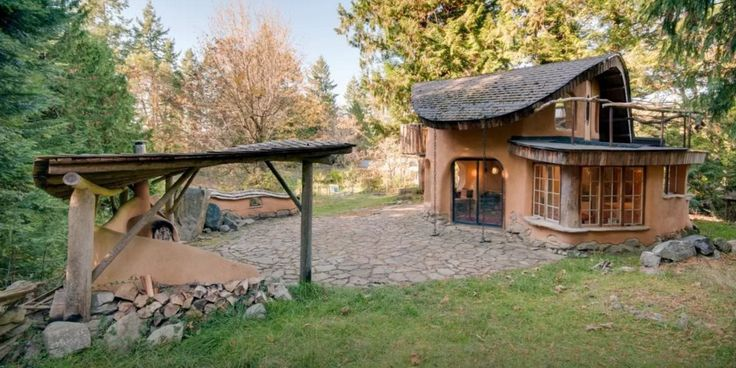 """The Mayne Island property, known as the """"Cob Cottage,"""" is the picture of peace and quiet, sitting on a property with orchards, gardens, and sheep, according to its listing."""