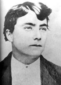 Tom McLaury. On October 26, 1881, during the gunfight at the O.K. Corral, Tom McLaury shot Morgan Earp in the shoulder. Doc Holliday instantly countered, blowing McLaury away with blasts from both barrels of his shotgun. His brother, Frank, was also killed in the gunfight. Both are buried at Tombstone's Boothill.