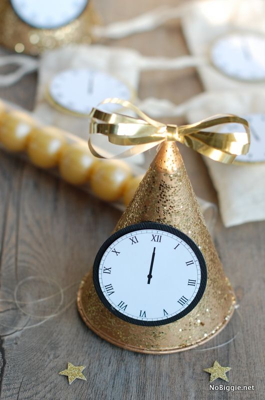 party hats to Celebrate New Year's Eve with this free printable - midnight clocks - via NoBiggie.net