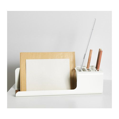 KVISSLE Desk organiser IKEA Holds your pens, rulers, mobile etc. Cork liner in the bottom keeps the things in place. £7