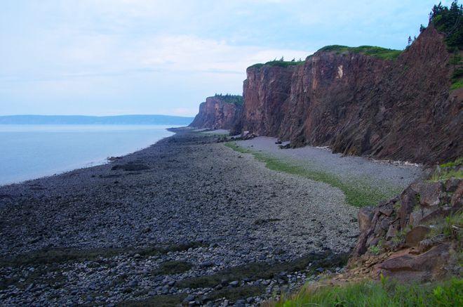 Huge cliffs near the Cape DOr Lighthouse in Nova Scotia