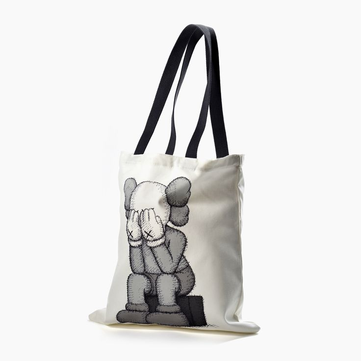 KAWS Passing Through Tote Bag:  Lined canvas bag designed by KAWS to accompany his 2016 exhibition at Yorkshire Sculpture Park.