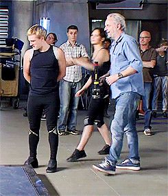Catching Fire Behind The Scene: Jen giving Josh a 'wet willy' on set Part 2 Josh looks so funny and look at F. Lawrence like he's so used to this he didn't even scold them LOL