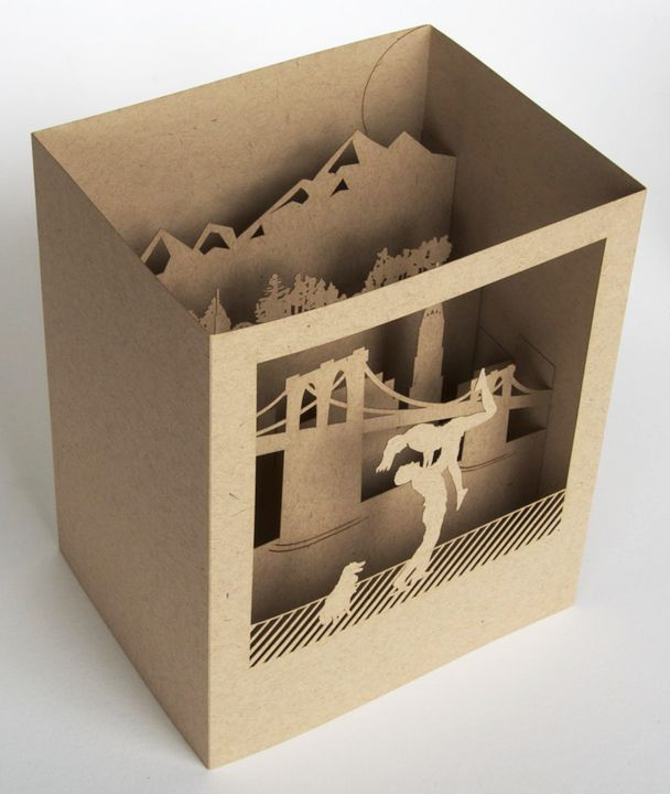 Cut craft paper diorama. This could be a die cut or laser cut print promotion with copy. It would need to be hand assembled and produced in volumes under 1500. It also could decorate an event or launch party.