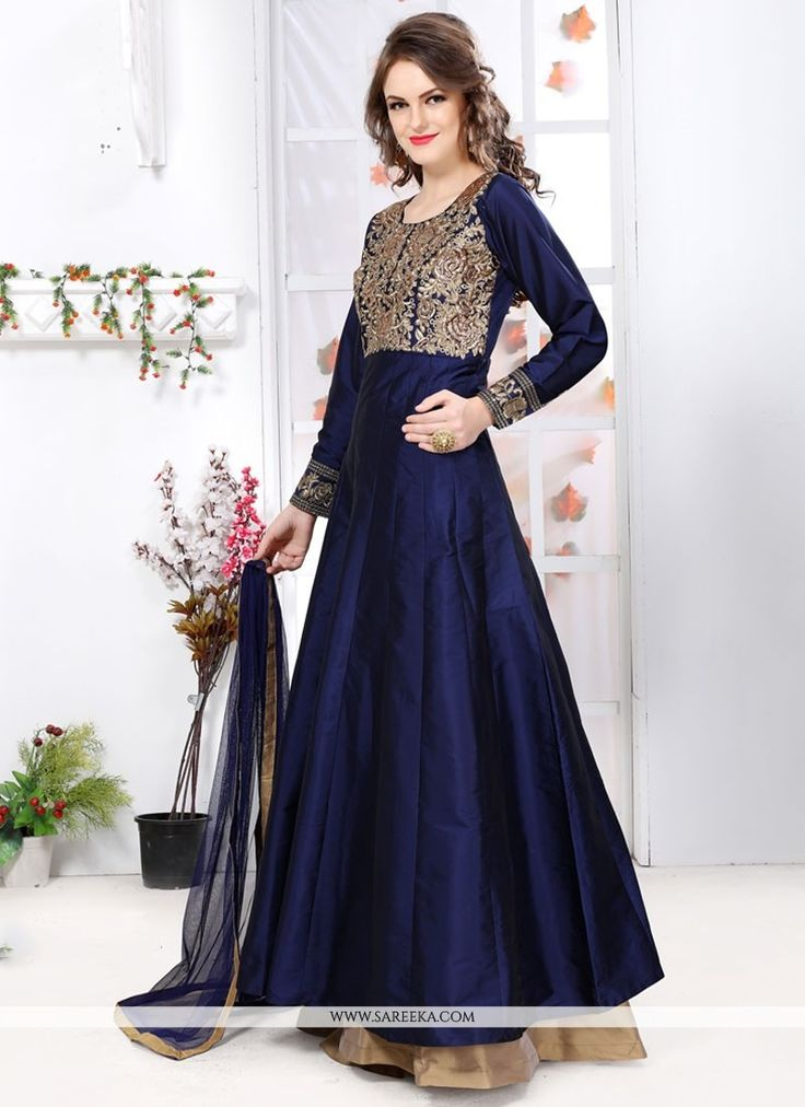 Look ethnic in this blue tafeta silk designer floor length suit. Look ravishing clad in this attire which is enhanced embroidered and resham work. Comes with matching bottom and dupatta. (Slight varia...