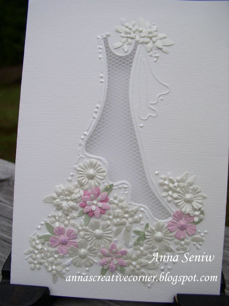 Today I finally was able to finish this very pretty bridal card.  The card already comes pre-made with the bridal dress cut out, a pretty la...