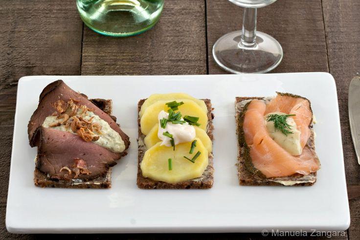 Three classic smorrebrod: roast beef, potatoes and smoked salmon