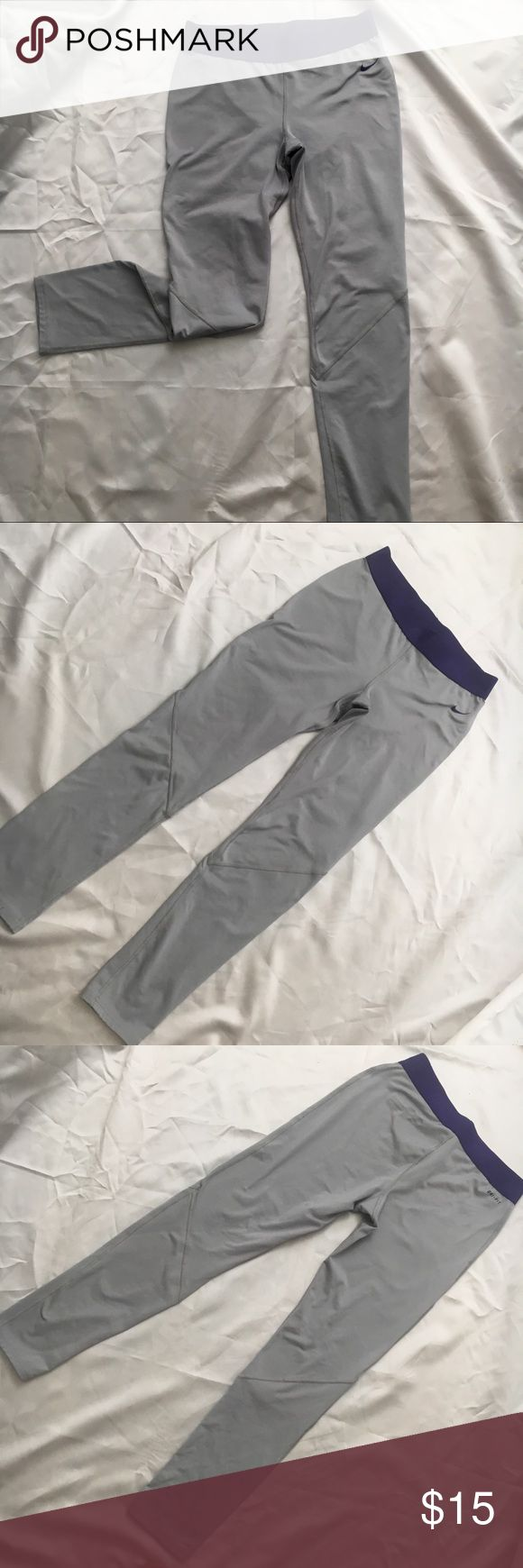 "Nike Dri-Fit Grey Active Pant Nice light grey/purple color combo. Polyester/spandex knit fabric fleece brush inner for colder weather.  This is a children's pant size XL but will fit a ladies size small or medium 5'4"" or shorter   Waist 26.5"" relaxed circ.  Inseam 26.5"" Leg opening 4.5"" Flat Nike Bottoms Leggings"