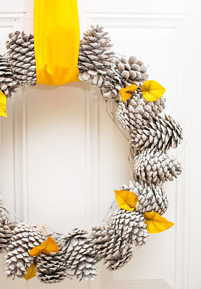 Using just a few materials, this pretty pine cone wreath is simple to create and makes a great statement on your front door.