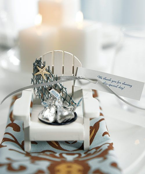 These adorable wooden painted deck chairs with tealight holder adorned with netting starfish They used placecard holders attaching they make unique bomboniere/favour adding candle some chocolates almonds holder
