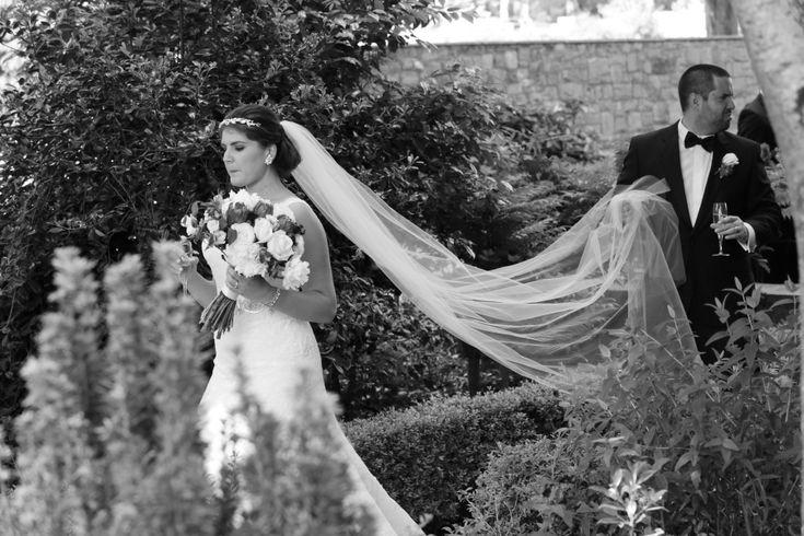 Groom carries veil