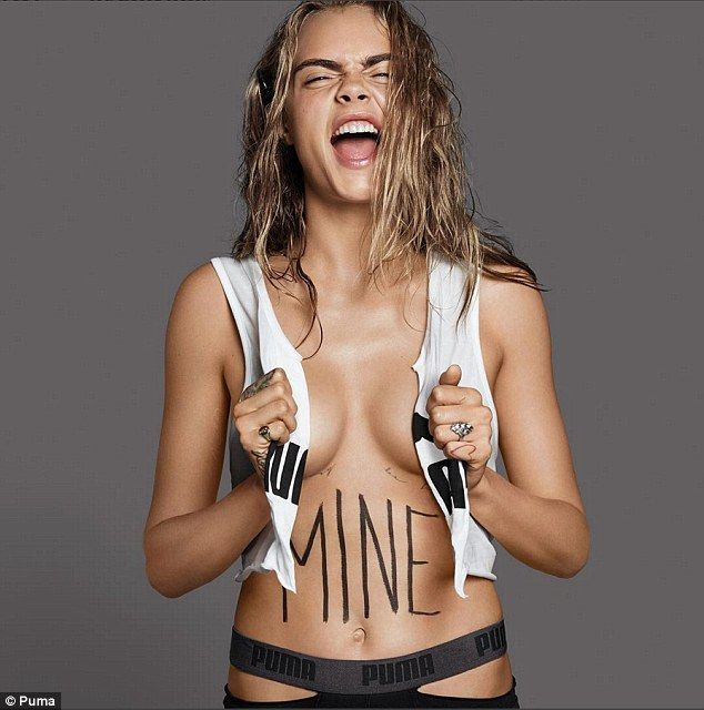 Poweful imagery: Cara Delevingne is certainly injecting some of her trademark raunch into the campaign, as she dares to nearly bare all in a daring and powerful new image