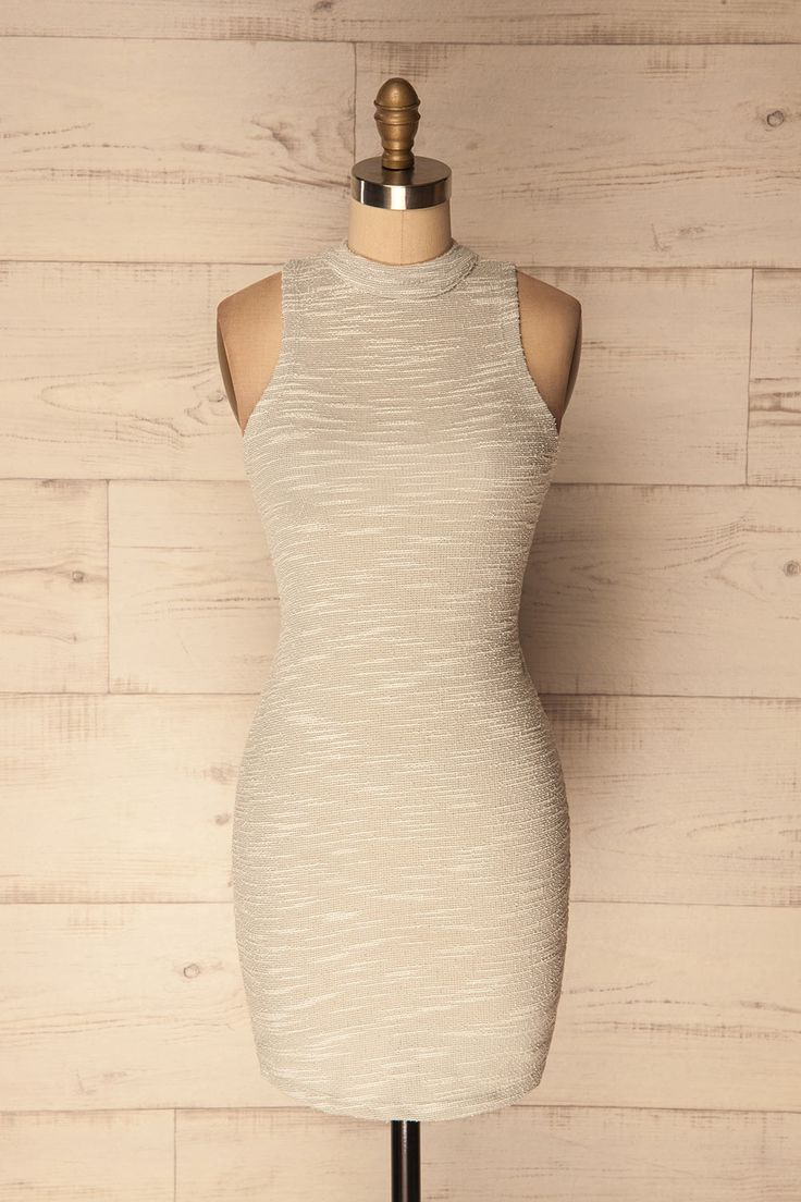 Gloucester #boutique1861 /  This sleeveless dress has a high collar and buttons up the back of the neck. Its textured grey and white material will compliment your figure and allows for versatility, leaving room for creativity so you can style it in your own unique way.