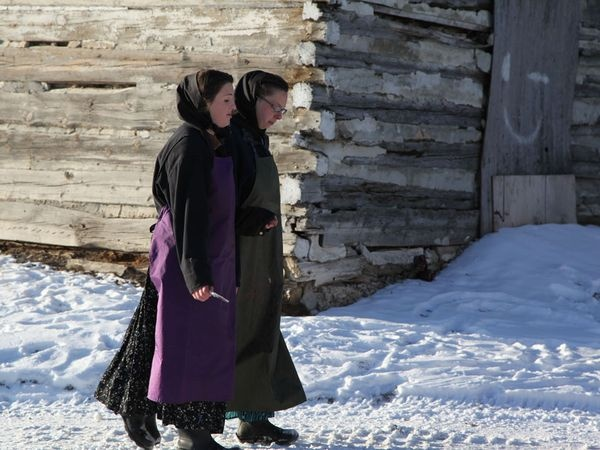 The Hutterites Claudia and Lisa Hofer walking in the snow.
