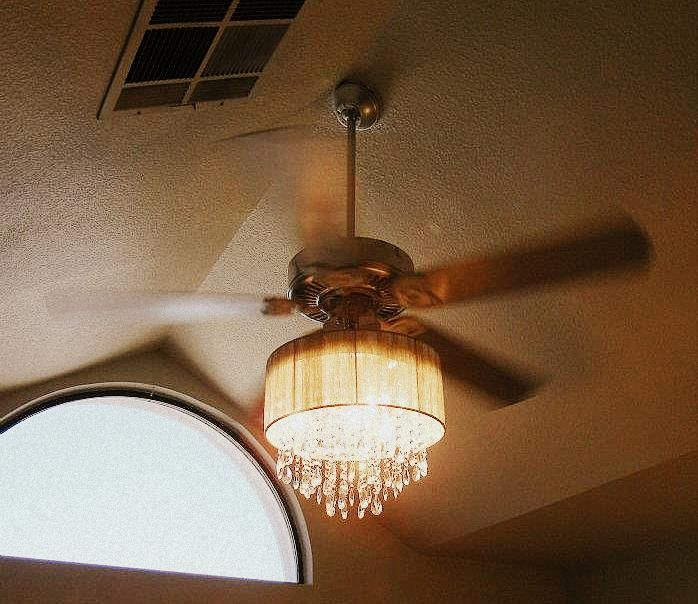 this lady combined a ceiling fan and crystal chandelier!