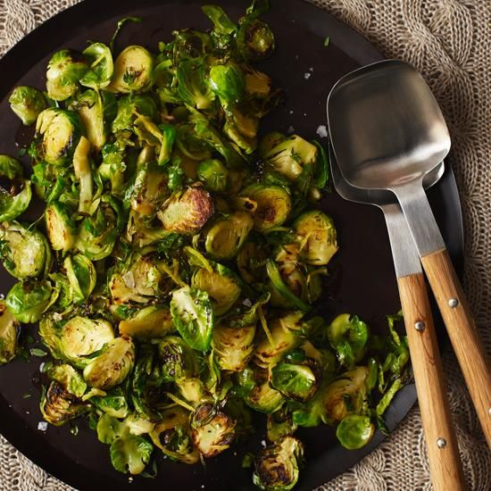 Brussels Sprouts with Lemon and Thyme | Chef Nuno Mendes separates brussels sprout leaves by hand before sautéing them, an extremely time-consuming task. Thinly slicing the sprouts vertically—by hand or with a food processor fitted with a slicing blade—gets similar results in a fraction of the time.