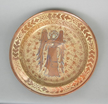 """Large Hispano-Moresque Pottery Bowl, ca. 15th/16th Century A.D.    A Hispano-Moresque glazed bowl with elaborate hand-painted design in copper lustre. Deep well/bowl with tall edge, expanding to raised lip. Rounded and flat bottom, no foot. Center with angle playing a lute. Approx. 16-3/4""""D x 2-3/4""""T."""