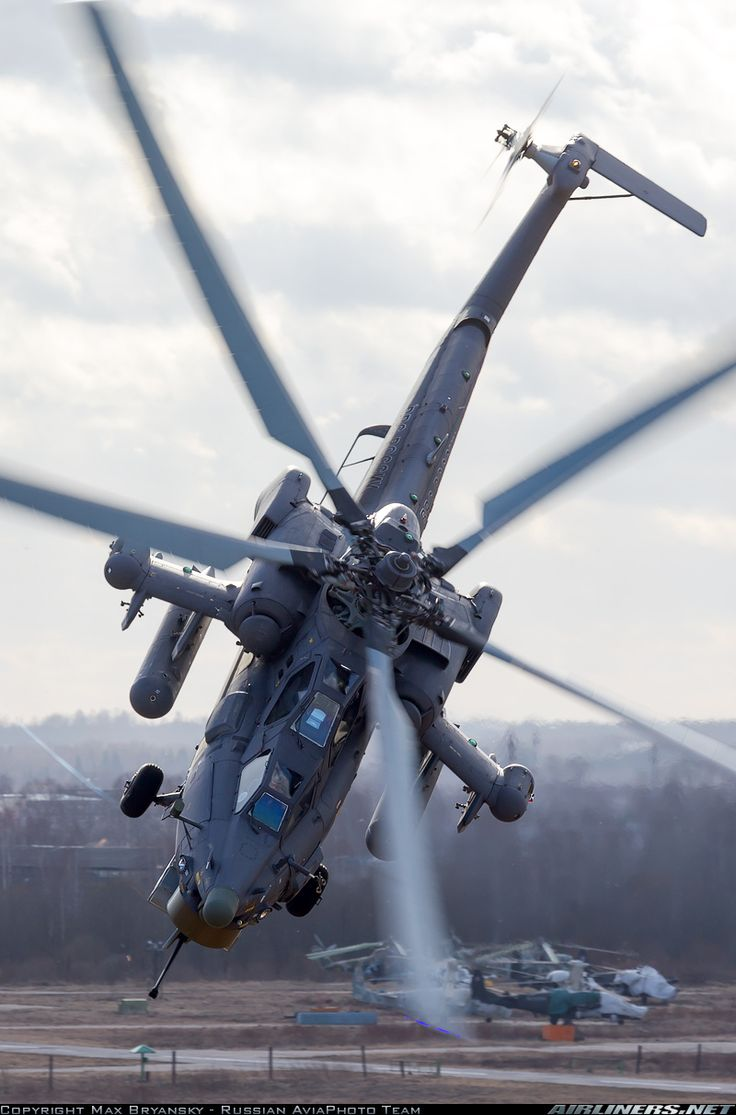 """helghasttactician: """"The pilot of this Mi-28N sure knows how to put it through it's paces. Almost seems like a scene from Battlefield 3. Note the Ka-52s in the background. There's also an Mi-24 back..."""