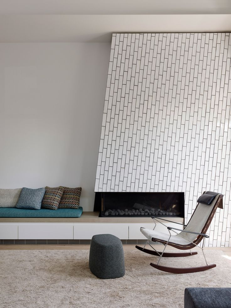 Alamo Square Residence by Jensen Architects // modern asymmetrical white fireplace design