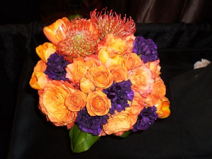 Bridal bouquet. Bride. Maid of honor. Bridesmaid. Flower girl. Orange. Purple. Rose. Carnation. Garden rose. Wedding. Fall. Summer. Spring.