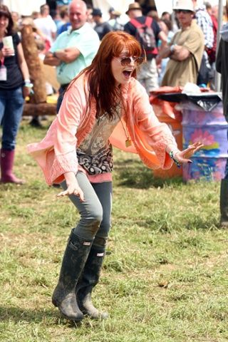 Shake it out: Florence Welch gets in the mood at Glastonbury.