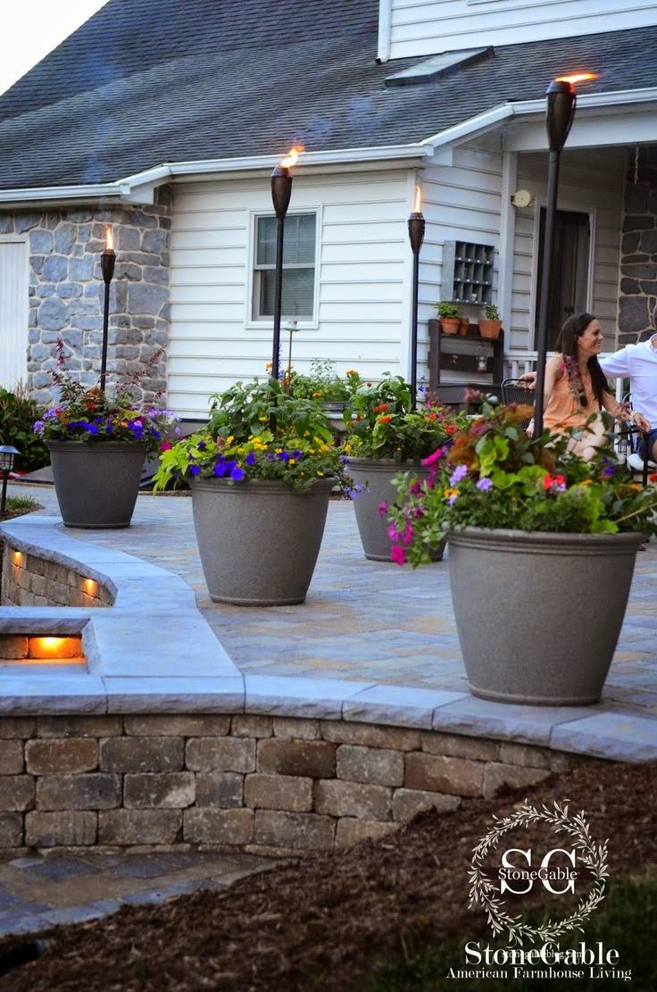 Raised patio ideas - I Like The Two Level Patio The Fire Pit The Lighting Pretty Much Everything About It I Want Big Pots With Flowers In It Like These