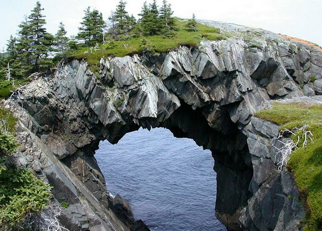 Berry Head Arch, Newfoundland. There are stranger, more spectacular places in the world, but this natural rock arch in Newfoundland has that certain Game of Thrones ruggedness about it. It is pretty impressive to see a rock arch so large that a grove of trees has grown atop it. Use it as a landmark location in your fantasy world. Better yet, set a major battle scene on top of it. Wizard vs. demon? Starks vs. Lannisters?