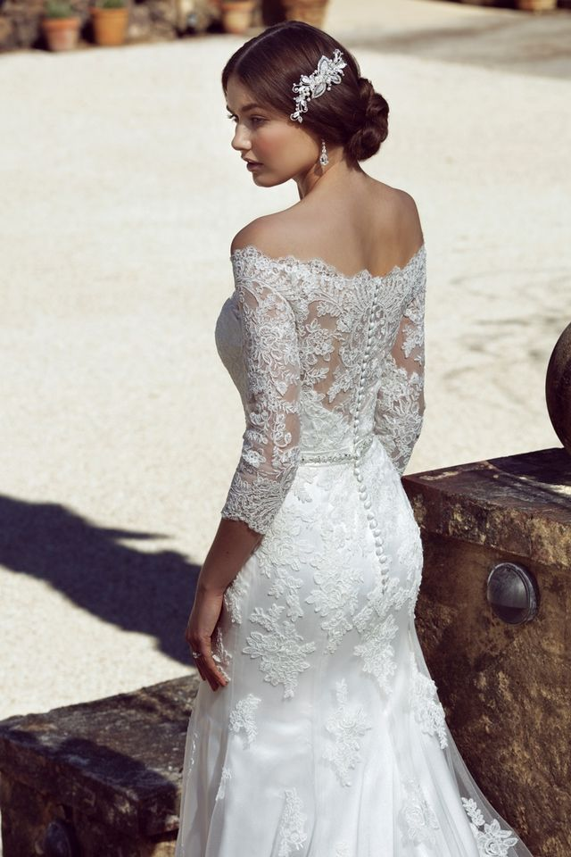 CAPRIE Is A Spanish Dancer Sweet Senorita And The Ultimate Rustic Wedding Gown With Her Off Shoulder Scalloped Lace Neckline Fitted Silhouette