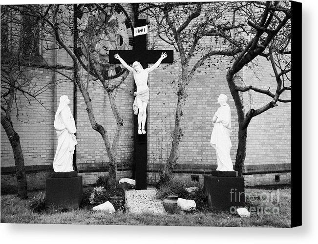 Crucifixion Scene At Saint Pauls Roman Catholic Church Falls Road West Belfast Northern Ireland Uk Canvas Print by Joe Fox. All canvas prints are professionally printed, assembled, and shipped within 3 - 4 business days and delivered ready-to-hang on your wall. Choose from multiple print sizes, border colors, and canvas materials.