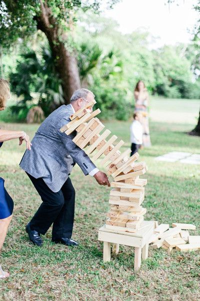 <strong class='info-row'>Brooke Images. A wedding photography company</strong> <div class='info-row description'>Everyone played lawn games, including giant Jenga.     Venue: The Ribault Club    Event Planner: Southern Charm Events</div>