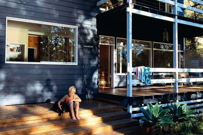 blue/grey exterior colour, wood deck