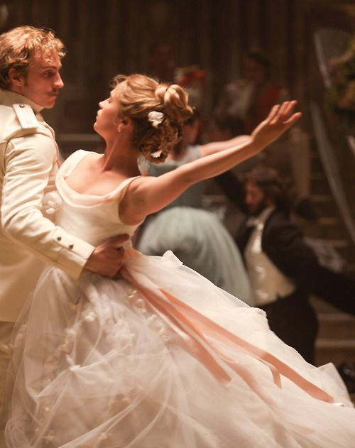 Aaron Taylor-Johnson as Vronsky and Alicia Vikander as Kitty in Anna Karenina (2012).