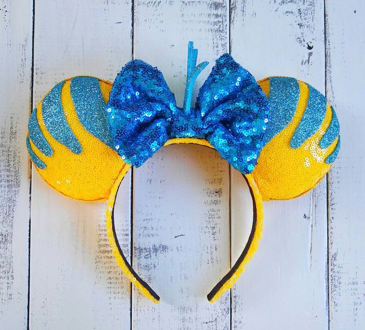 Flounder - Little Mermaid Inspired Ears by EverAfterByPatti on Etsy https://www.etsy.com/listing/543138169/flounder-little-mermaid-inspired-ears