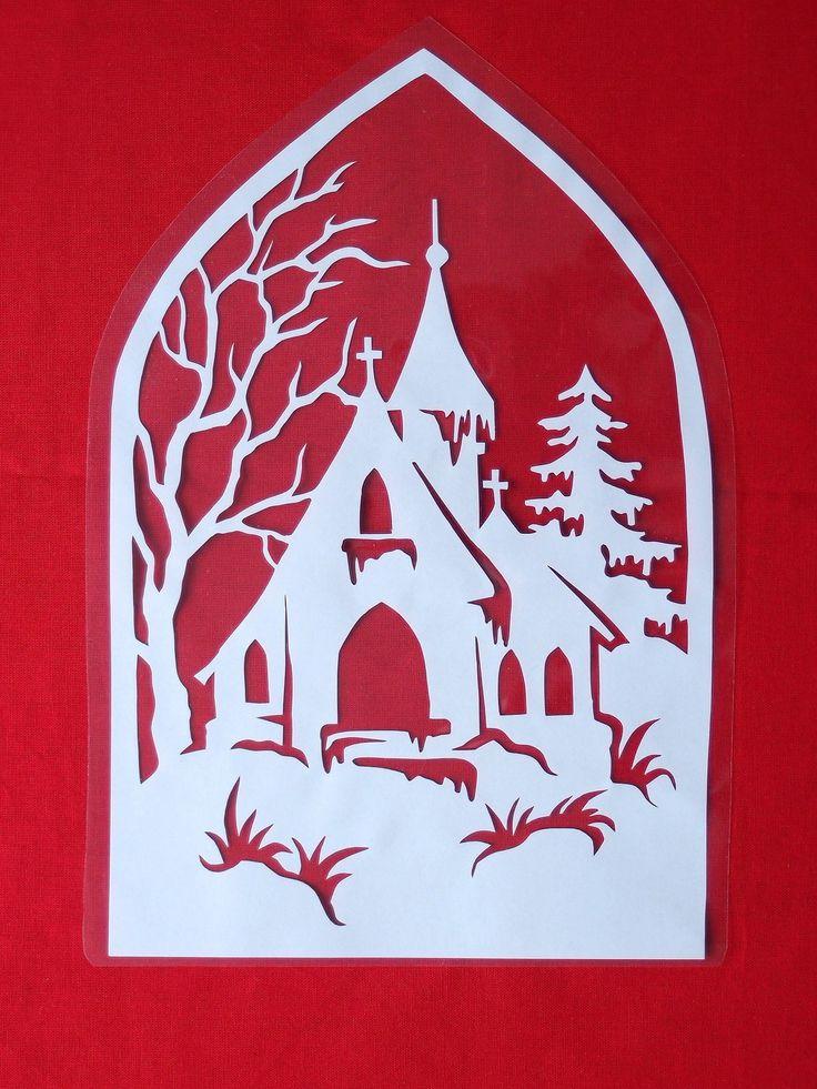 Vánoční vystřihovánka do okna - Zasněžený kostel Papírová vystřihovánka zatavená ve folii - pro opakované použití. Velikost vystřihovánky (i s folií) 28 x 19 cm