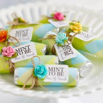 view this homemade gift   Mint To Be Wedding Favors  These little favors are affordable and easy to make.  Plus, all the guests will love them.  Buy rolls of breath mints online in bulk, wrap them in cute scrapbook paper and add customized tags.  Embellish with little flowers as shown or get creative with other shapes like hearts, birds, etc.