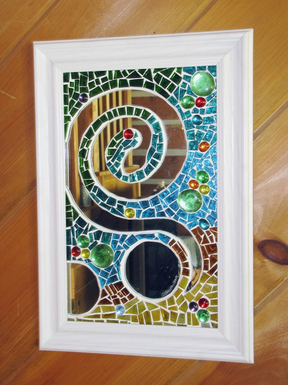 Awesome idea, mosaic on top of a mirror, leave parts of mirror exposed.