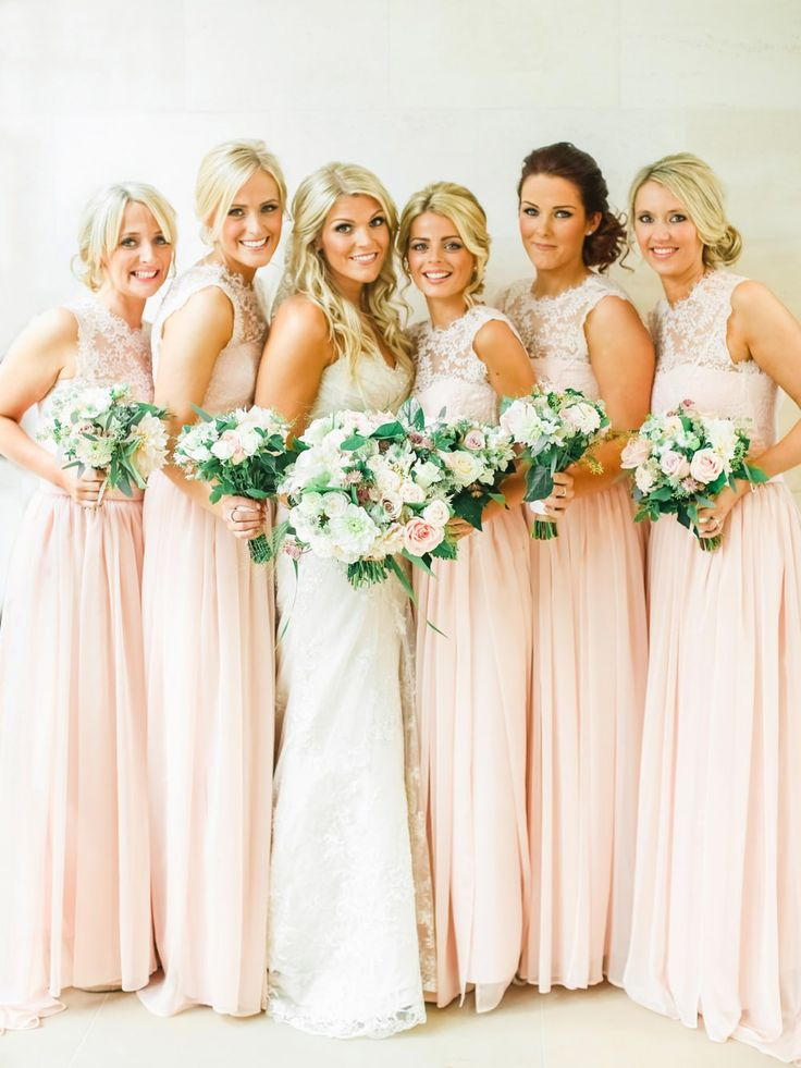 Bespoke Blush / Peach Pink Bridesmaid dresses with lace high necks - Image by  Belle and Beau Photography - An Ian Stuart 'Sapphire' bridal gown for a classically romantic wedding at Rudding Park in Harrogate with a Dahlia bouquet and pink bridesmaid dresses www.rockmywedding.co.uk