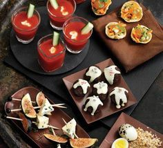 Party nibbles (Bloody Mary shots / quails' eggs with sesame dukka / avocado tarts / parsnip chips with maple-mustard dip / halloumi dippers with chilli pineapple salsa / Greek kebabs with houmous & tzatziki / poppadoms with mango chutney / fig & blue cheese skewers / cranberry & orange scones)