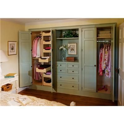 This Custom Built-In Closet from Crown Point Cabinetry is a perfect example of transforming a reach in closet it in to a luxurious dressing room.  The Designers use of space speaks volumes about his or her ability to see the space and understand the USE of the space.       True furniture style, with exquisite color. (Note the door panel detail) A simple, but elegant style for any decor  (The Closet Critique by HouseOrganized.com)
