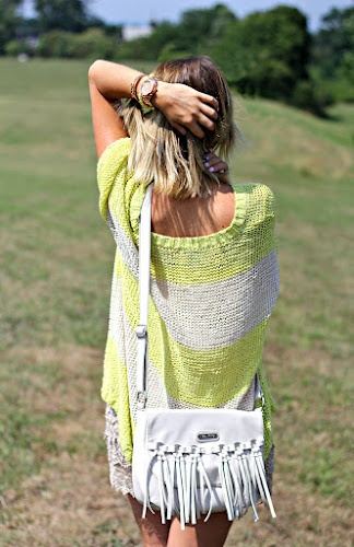 Pop! of Style blogger Missy wears our very own Fringe Messenger Bag.