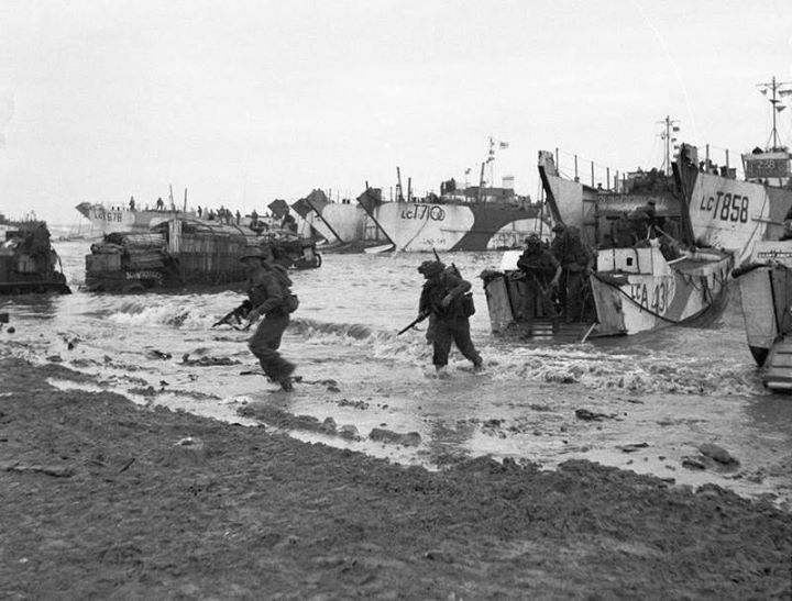 D-day - British Forces during the Invasion of Normandy 6 June 1944 Commandos of 47 (RM) Commando coming ashore from LCAs (Landing Craft Assault) on Jig Green beach Gold area 6 June 1944. LCTs can be seen in the background unloading priority vehicles for 231st Brigade 50th Division.