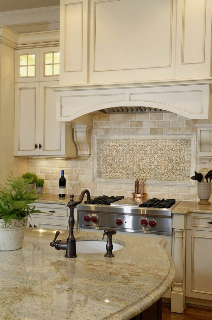 Monochromatic creams for cabinets, countertops and backsplash...  The curved and rounded edges are great for Feng Shui energy--no poison arrows!