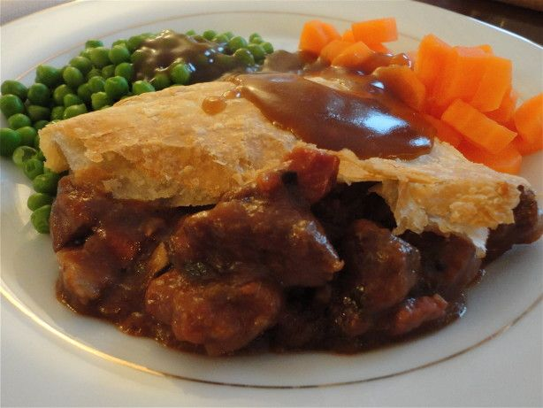A traditional steak and Guinness pie done by my favorite British chef, Jamie Oliver. This is made particularly easy by using puff pastry for the top pie layer!  If you want to skip the puff pastry layer, you could serve this as a normal stew. The herbs listed are just a suggestion. Jamie typically leaves the amount and type up to the cooks personal tastes. He suggests a handful.  I did change the recipe a little bit from his, due to personal preferences. Feel free to substitute out the ...