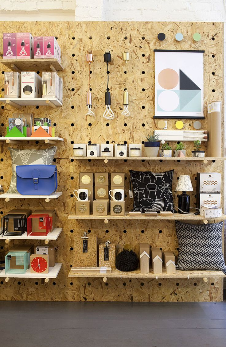 OSB peg board walls..... I love merchandising these walls! That & doing the window is my favourite job!! Ongl Design + Make designed my shop & what a top job they did!