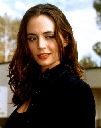 Eliza Dushku. I always loved Faith on Buffy, but I also loved Tru Calling and Dollhouse. Eliza seems like a really cool, down to earth gal.