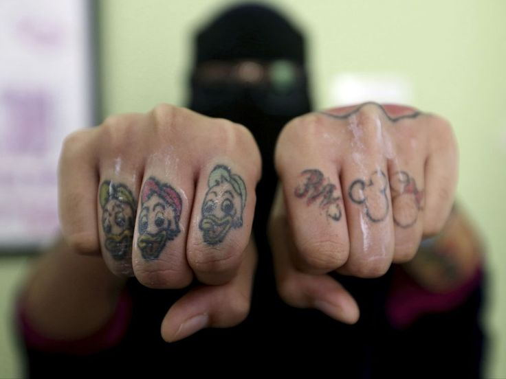 Indonesia clinic gives relief to Muslims with tattoo regrets - National Post