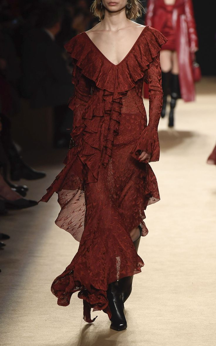 This Roberto Cavalli Lace Ruffle Dress features a V neckline, cascading ruffle detail, and asymmetric hemline.