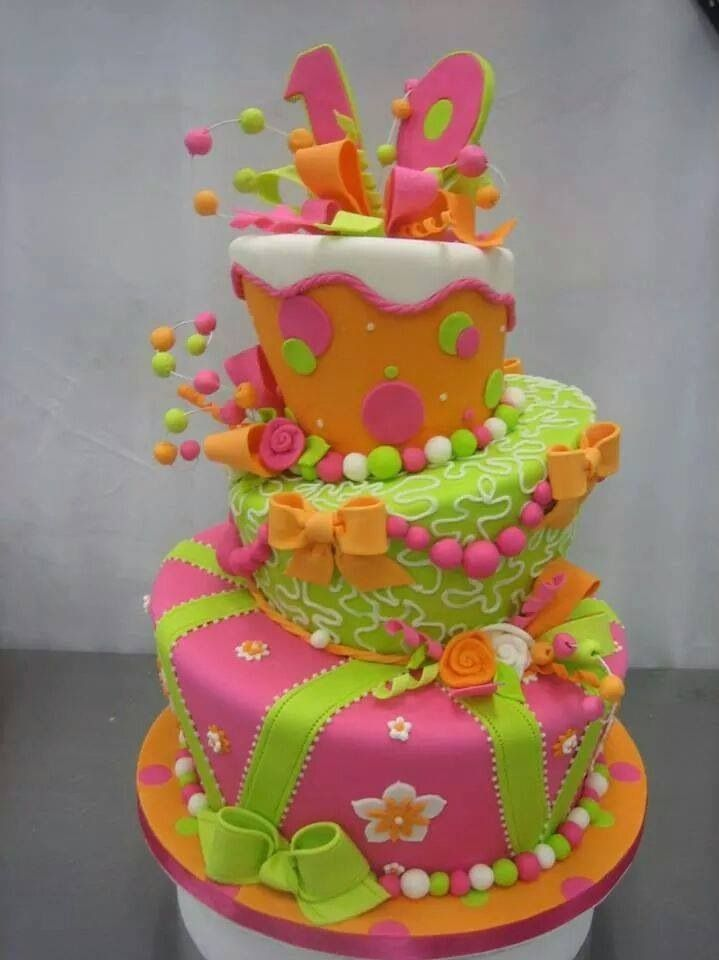 Topsy Turvy Cake.  I love the little balls on wires sticking out of the cake and all the details are cute!