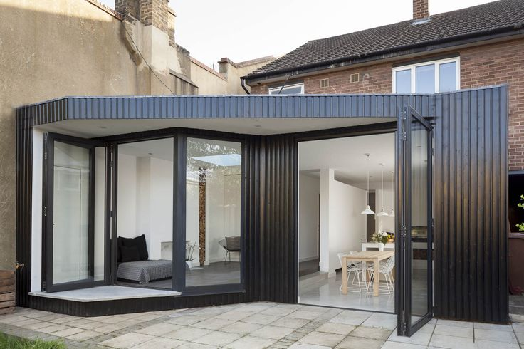 Annis Road, London E9 Back extension, seating are leading to an outdoor covered space