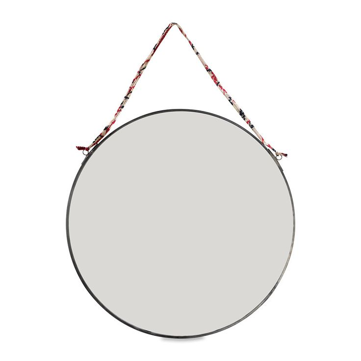 Add an artisanal touch to any interior with this Kiko round mirror from Nkuku. Hanging from a recycled sari tie, the Kiko round mirror is a striking addition to any interior and the zinc has been skil